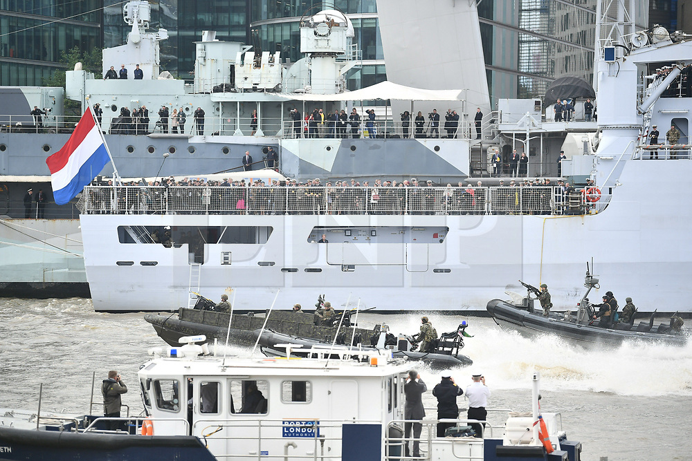 © Licensed to London News Pictures. 24/10/2018. London, UK. British Royal Marines are joined by the The Royal Netherlands Marines and police forces in a military demonstration at HNLMS Zeeland, which is anchored next to anchored next to HMS Belfast on the River Thames in central London. Members of the British and Dutch Royal families watched the event as part of a state visit to the UK. Photo credit: Ben Cawthra/LNP