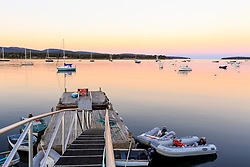 Boats on Mansett harbor at sunset on Mount Desert Island, Maine.