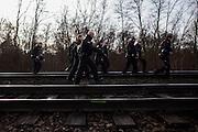 Magdeburg | 18 Jan 2014<br /> <br /> ACHTUNG BESONDERE HONORARKONDITIONEN!<br /> <br /> Am Samstag (19.01.2014) marschierten etwa 1000 Neonazis bei einem &quot;Gedenkmarsch&quot; durch Magdeburg, um der Bombardierungen der Stadt im 2. Weltkrieg zu &quot;gedenken&quot;.<br /> Hier: Beamte der Bundespolizei rennen bei der Haltestelle Magdeburg-Heidekrug &uuml;ber Bahngleise, um zu einer Gleisblockade von Anti-Nazi-Demonstranten zu gelangen.<br /> <br /> &copy;peter-juelich.com<br /> <br /> [No Model Release | No Property Release]