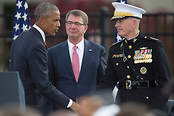 September 11, 2016 - Arlington, United States of America - U.S President Barack Obama shakes hands with Chairman of the Joint Chiefs Gen. Joseph F. Dunford Jr., as Defense Secretary Ash Carter looks on after a ceremony commemorating the 15th anniversary of the 9/11 terrorist attacks at the Pentagon September 11, 2016 in Arlington, Virginia. (Credit Image: © Po2 Dominique A. Pineiro/Planet Pix via ZUMA Wire)