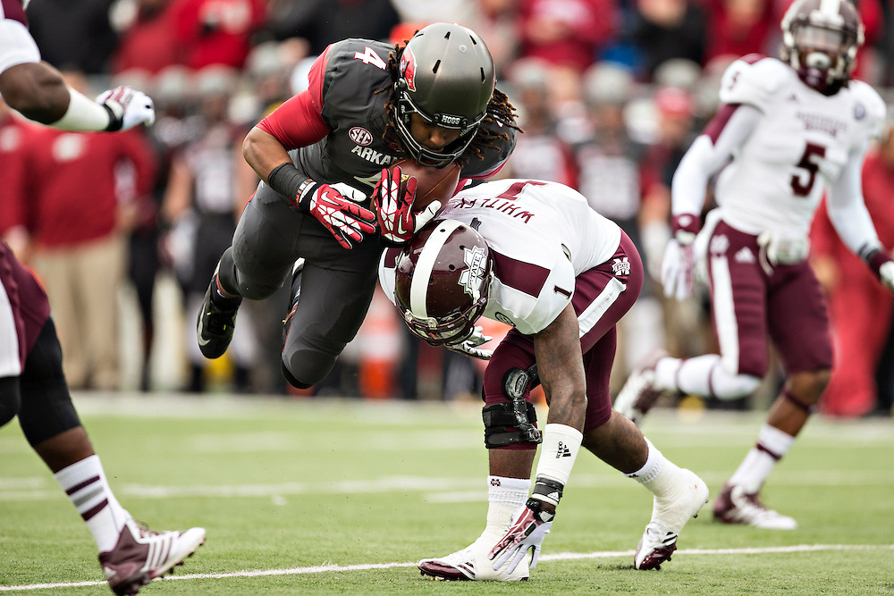 LITTLE ROCK, ARKANSAS - NOVEMBER 23:  Keon Hatcher #4 of the Arkansas Razorbacks is tackled by Nickoe Whitley #1 of the Mississippi State Bulldogs at War Memorial Stadium on November 23, 2013 in Little Rock, Arkansas.  The Bulldogs defeated the Razorbacks 24-17.  (Photo by Wesley Hitt/Getty Images) *** Local Caption *** Keon Hatcher; Nickoe Whitley