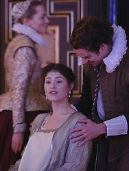 """© Licensed to London News Pictures. 14 January 2014. London, England. L-R: DENSE GOUGH as Julia, GEMMA ARTERTON as The Duchess and ALEX WALDMANN as Antonio.  Actress Gemma Arterton stars as the Duchess in the play """"The Duchess of Malfi"""" by John Webster. This is the first production to take place at the Sam Wanamaker Playhouse at the Globe Theatre. The performance is only lit by candles. Directed by Dominic Dromgoole. Photo credit: Bettina Strenske/LNP"""