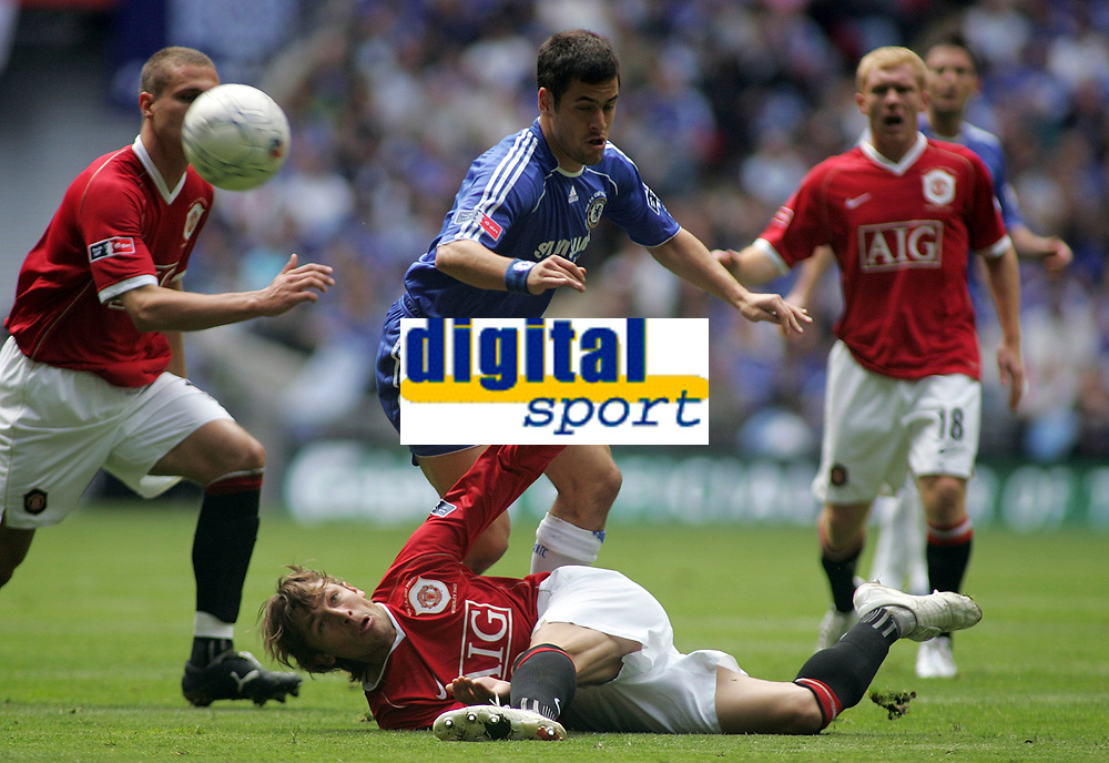 Photo: Paul Thomas.<br /> Chelsea v Manchester United. The FA Cup Final. 19/05/2007.<br /> <br /> Gabriel Heinze (Ground) of Utd clears from Joe Cole.