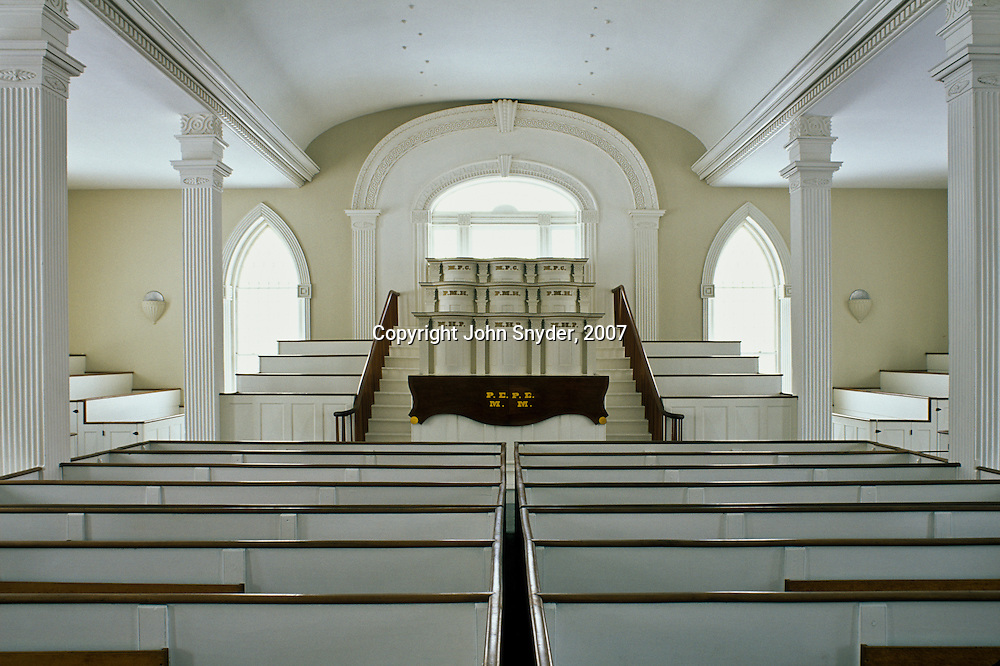 Light emanates from the windows in the main assembly hall of the Kirtland Temple in Kirtland, Ohio near Cleveland. The temple, completed in 1836 at great personal expense by early members of the Mormon Church (The Church of Jesus Christ of Latter-day Saints), is now owned and maintained by the Community of Christ based in Independence, Missouri.