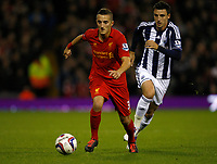 Football - Carling Cup- West Bromwich Albion v Liverpool -Liverpools' Samed Yesil beats West Broms' George Thorne at The Hawthorns