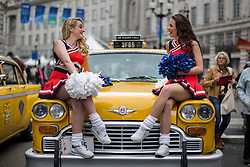 © licensed to London News Pictures. London, UK 12/05/2013. Cheerleaders posing on classic American taxis as they represent the USA at The World on Regent Street event in London on Sunday, 12 May 2013. Many countries showcase the best of each country's culture, music and dance, art, food and fashion to Londoners on Regent Street. Photo credit: Tolga Akmen/LNP