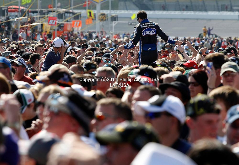 7-9 October, 2011, Kansas City, Kansas, USA<br /> Jimmie Johnson high-fives fans during driver intros.<br /> (c)2011, Phillip Abbott<br /> LAT Photo USA