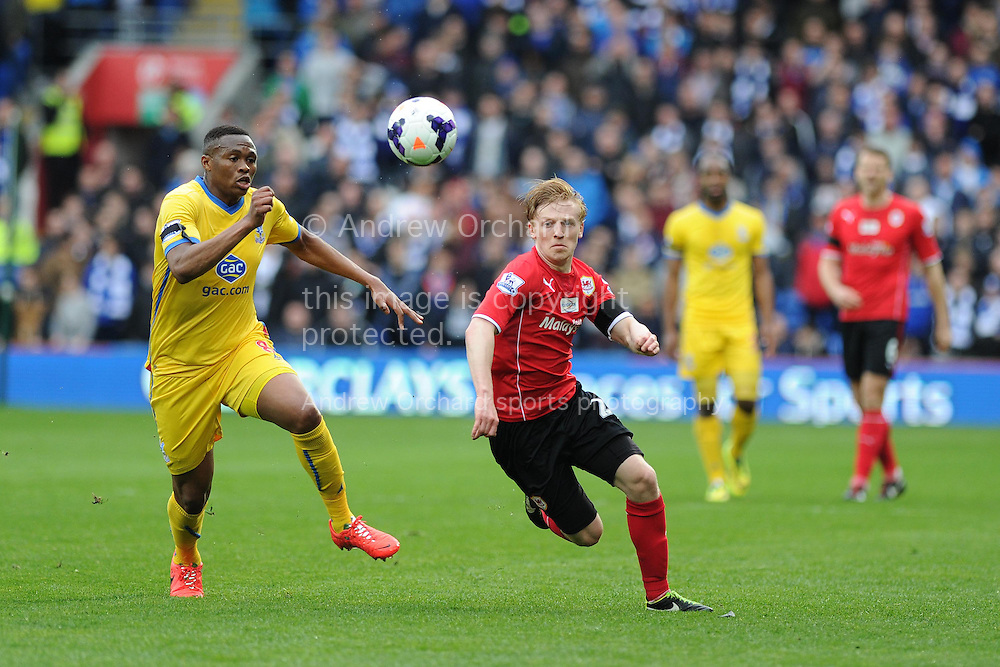 Mats Daehli of Cardiff city &reg; breaks away from Kagisho Dikgacoi of Crystal Palace . Barclays Premier league match, Cardiff city v Crystal Palace at the Cardiff city stadium in Cardiff, South Wales on Saturday 5th April 2014.<br /> pic by Andrew Orchard, Andrew Orchard sports photography.