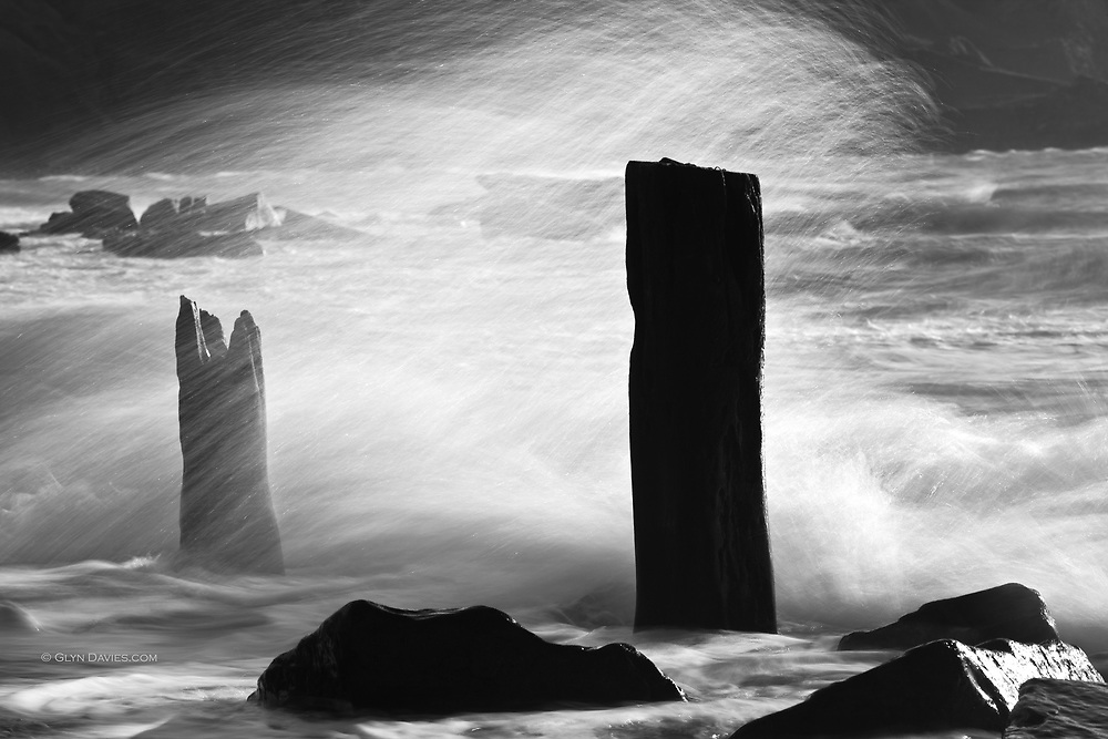 """Two of the last few stumps of the cargo jetties stand defiantly against the continual battering of the sea, the last tiny reminders of the link with the sea, from an industry long gone and a community dispersed""<br />