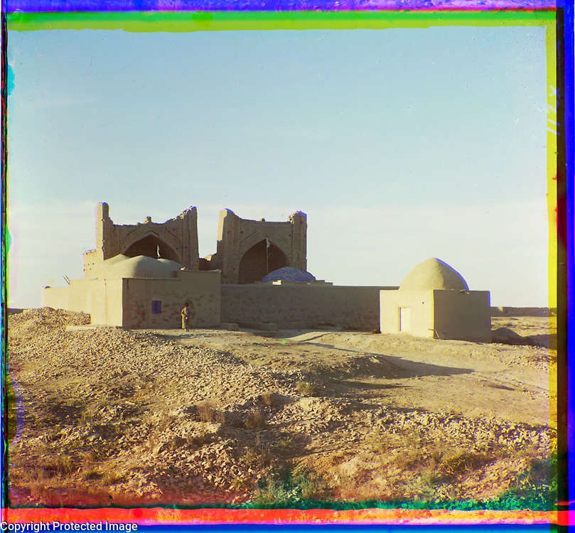 1905<br /> Shown here is a memorial shrine dedicated to the burial place of two brothers, Gifarya and Bureyda, who bore the title askhab (close associates of the Prophet Muhammed) in the 7th century. It is located near the ancient city of Merv, now Mary, on the Murghab River (present-day Turkmenistan). The core of the shrine was built in the 15th century and consists of two structures, each of which has a main facade with a peshtak (large pointed arch). The facades were richly decorated with ceramic tiles in geometric and inscriptional patterns. The original complex is fronted with domed structures added in the 19th century. The image is by Russian photographer Sergei Mikhailovich Prokudin-Gorskii (1863&ndash;1944), who used a special color photography process to create a visual record of the Russian Empire in the early 20th century. Some of Prokudin-Gorskii&rsquo;s photographs date from about 1905, but the bulk of his work is from between 1909 and 1915, when, with the support of Tsar Nicholas II and the Ministry of Transportation, he undertook extended trips through many different parts of the empire. Prokudin-Gorskii was particularly interested in architectural and archeological monuments in recently acquired territories of the Russian Empire such as Turkestan (present-day Uzbekistan and neighboring states) in Central Asia, which he visited on a number of occasions, including two trips in 1911.