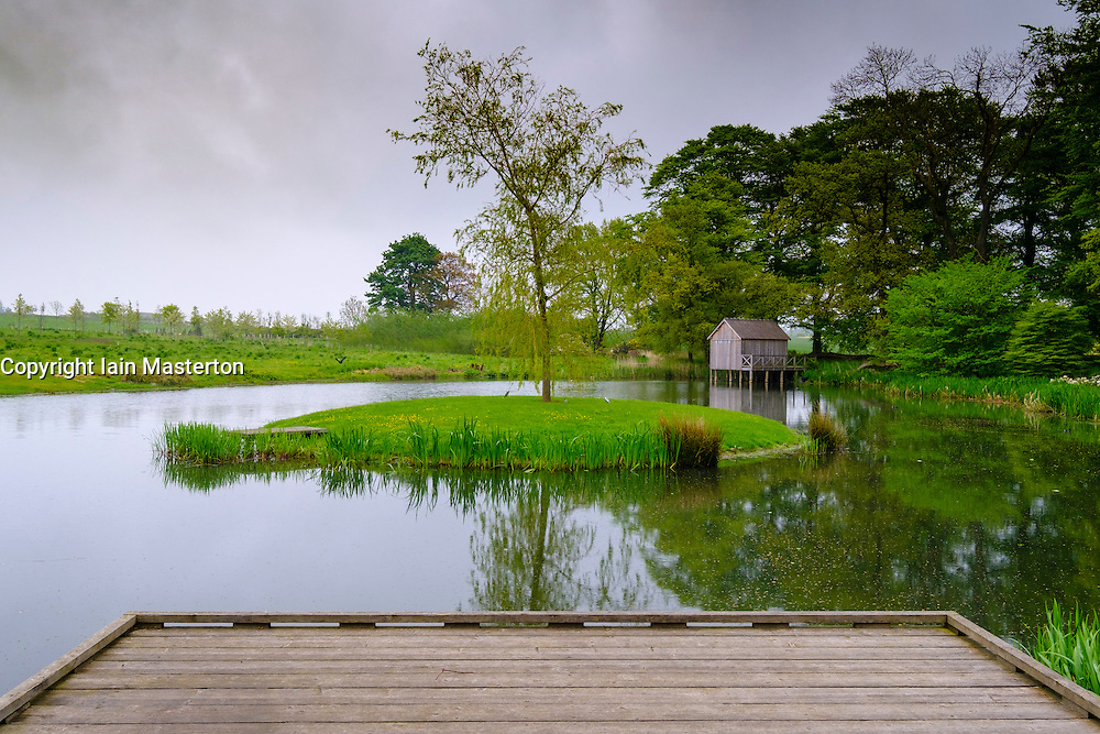 The Duck Pond with boathouse sculpture Rivers by Tania Kovats  at Jupiter Artland outside Edinburgh , Scotland , United Kingdom; editorial use only