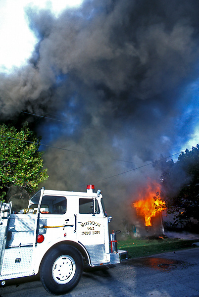 Stock photo of the Houston Fire Department on the scene of a house fire