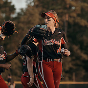 Pitcher, Monica Abbott, congratulates teammates following a play. The Scrap Yard Dawgs won the game 1-0.<br /> <br /> Todd Spoth for The New York Times.