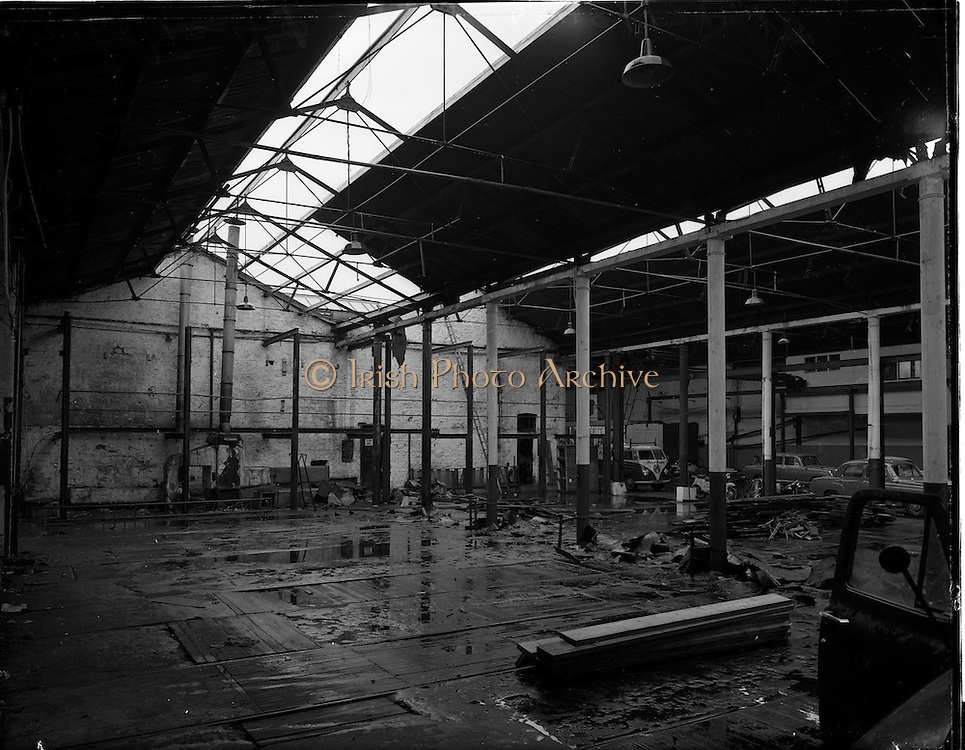 08/12/1959<br /> 12/08/1959<br /> 08 December 1959<br /> Pictures of the interior of Ballsbridge Motors, Shelbourne Road,  Dublin, before renovation. The premises had been a tram depot until the 1940's. Note Volkswagen van in right background.