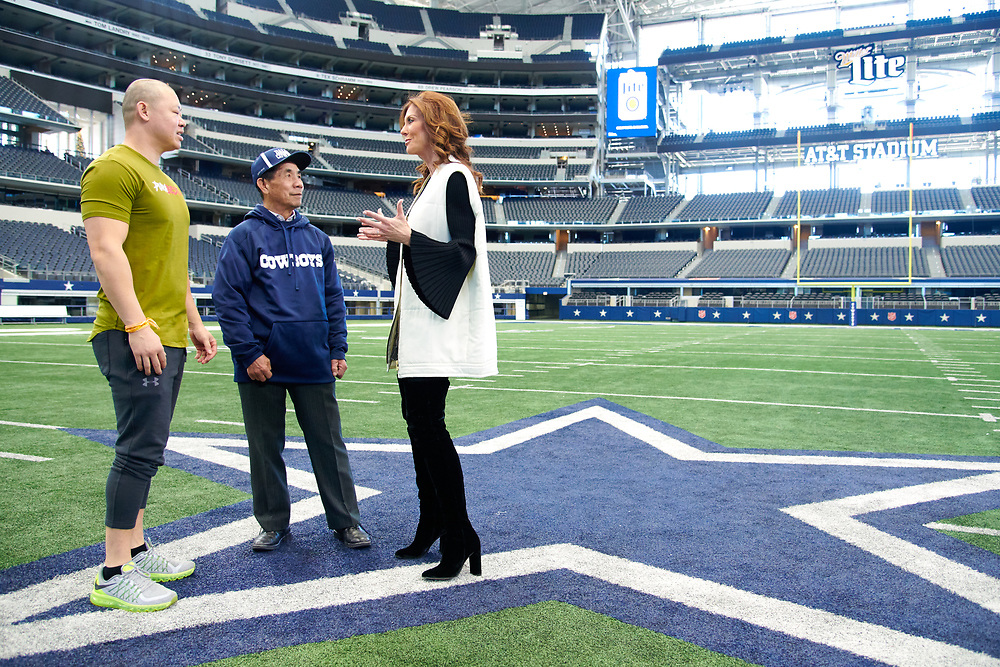 Charlotte Jones Anderson visits with visitors on the football field at AT&T Stadium in Arlington, Texas on December 12, 2017. (Cooper Neill for The New York Times)