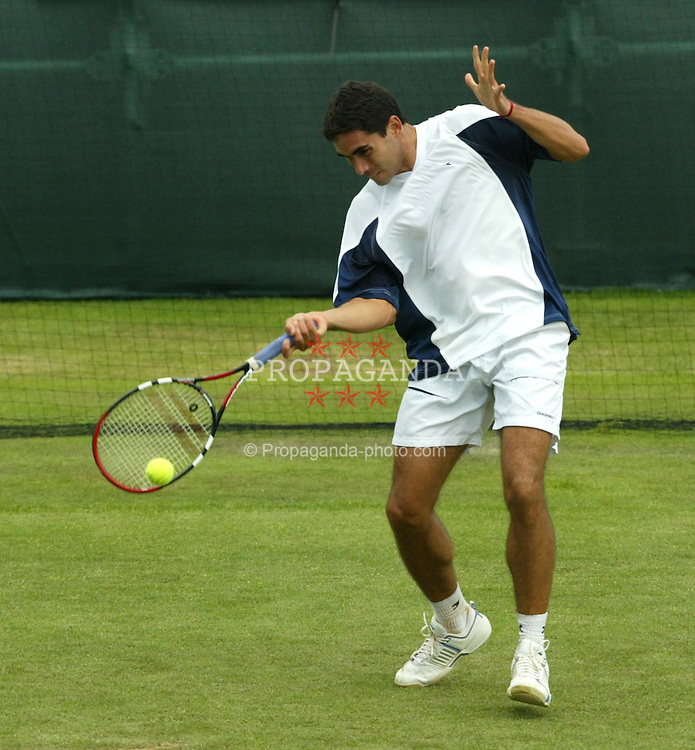 LIVERPOOL, ENGLAND - THURSDAY JUNE 10 2004: Ramon Delgado (PAR) in action during the Liverpool International Tennis Tournament in Claderstones Park. Delgado lost to Labadze 6-7, 6-3, 10-6 (Super tie-break). (Photo by David Rawcliffe/Propaganda)