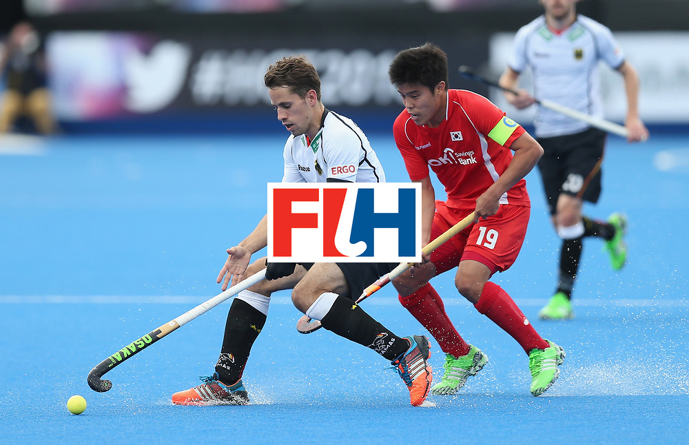 LONDON, ENGLAND - JUNE 16: Benedict Furk of Germany and Hyosik You of Korea during the FIH Mens Hero Hockey Champions Trophy match between Korea and Germany at Queen Elizabeth Olympic Park on June 16, 2016 in London, England.  (Photo by Alex Morton/Getty Images)
