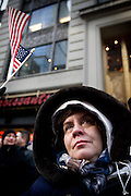 20th January 2009, the inauguration of President Obama..Time stands still as Americans unite at Time Square, New York City, to watch the jumbotrons with hope and joy as the 1st African-American President of USA takes the oath to lead the country through difficult times.  A woman cries as Barack Obama is sworn in as America's 44th President...Image © Arsineh Houspian/Falcon Photo Agency