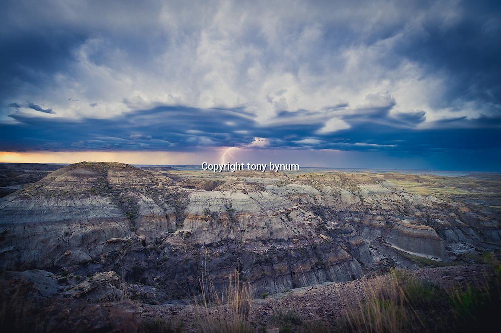 montana badlands lighting and huge storm clouds over badlands