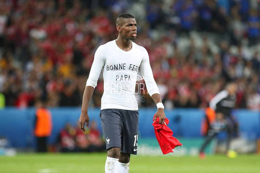 France Midfielder Paul Pogba with message Bonne Fete Papa on his shirt during the Euro 2016 Group A match between Switzerland and France at Stade Pierre Mauroy, Lille, France on 19 June 2016. Photo by Phil Duncan.