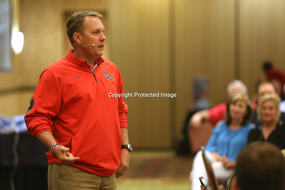 Ole Miss football head coach Hugh Freeze speaks to the alumni gathered Wednesday evening during the Rebel Roadshow at the BancorpSouth Conference Center.