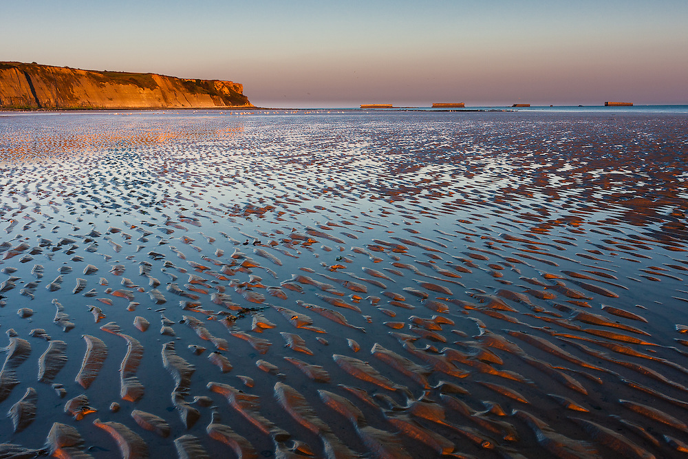 Early morning light at the beach of Arromanches-les-Bains, also known as Gold Beach, one of the beaches of the Allied Landing in Normandy during World War II