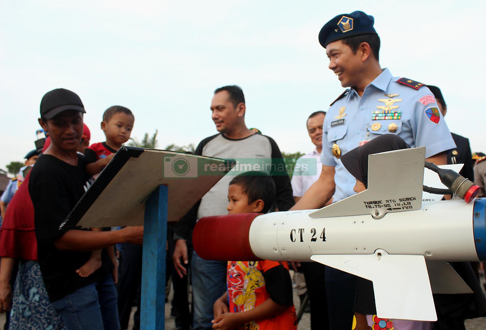 October 5, 2018 - Madiun, East Java, Indonesia - Commander of the Air Base Iswahjudi Magetan, First Marshal [Marsma] Indonesian National Army Samsul Rizal [right] greets residents while reviewing the exhibition stand The Main Tool of the [Alutsista] Armament System at Madiun City Square, September 5, 2018. Alutsista Exhibition held for three days that is in the framework of the 73rd Indonesian National Army Anniversary (Credit Image: © Ajun Ally/Pacific Press via ZUMA Wire)