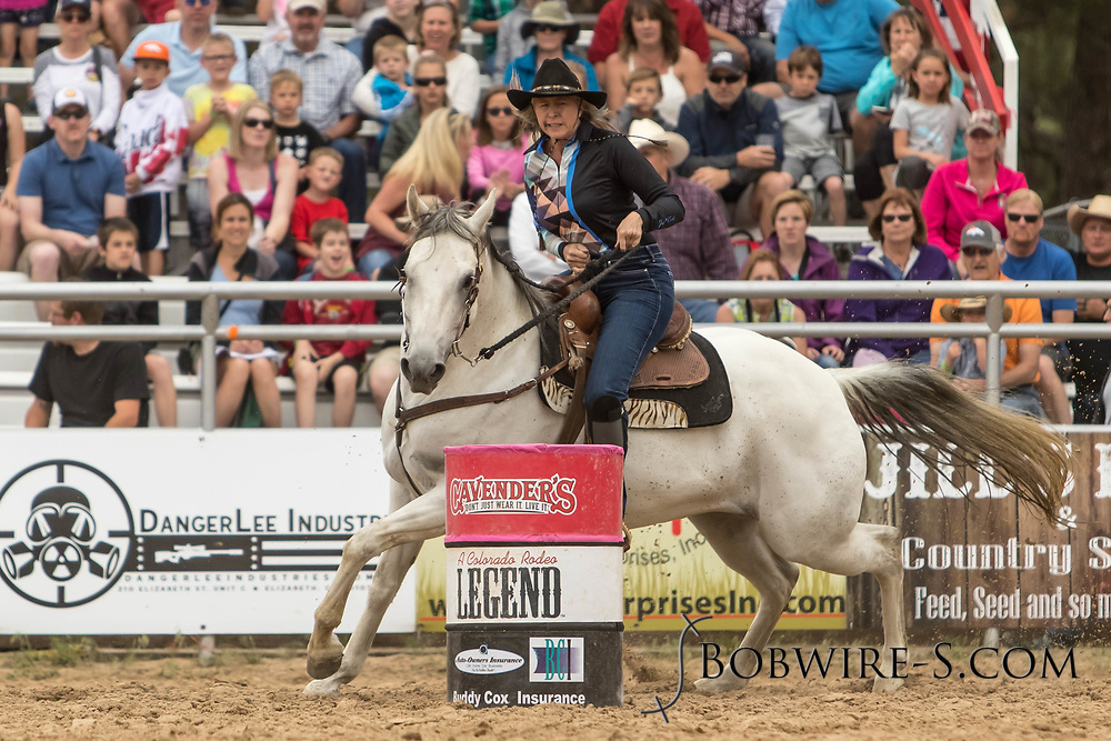 Robin Augustad makes her barrel racing run during the third performance of the Elizabeth Stampede on Sunday, June 3, 2018.