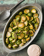 Roasted Brussels Sprouts.<br /> FOOD STYLING: Natalie Wise <br /> Food Photography by VT Photographer Oliver Parini.