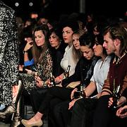 NLD/Amsterdam/20130318 - Modeshow Jan Boelo zomer 2013, Caro Emerald bekijkt de modellen