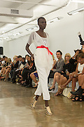 White calf-length pants and layered eyelet lace top. By Carmen Marc Valvo at the Spring 2013 Fashion Week show in New York.