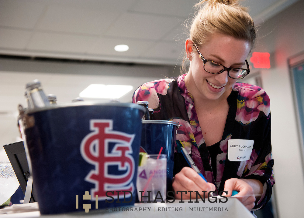 2 JUNE 2016 -- ST. LOUIS -- Abby Buchmann of HOK records her score on the fifth hole while participating in Putt and Prosper 2016 at the offices of Anders CPAs + Advisors in downtown St. Louis Thursday, June 2, 2016. An after work happy hour sponsored by Anders' Young Professional Group for employees, customers and friends, Putt and Prosper scattered putt-putt holes throughout the firm's offices and raised funds for Stray Rescue of St. Louis. Photo © copyright 2016 Sid Hastings.