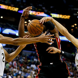 Oct 23, 2013; New Orleans, LA, USA; New Orleans Pelicans power forward Anthony Davis (23) and shooting guard Austin Rivers (25) defend against Miami Heat shooting guard Dwyane Wade (3) during the second half of a preseason game at New Orleans Arena. The Heat defeated the Pelicans 108-95. Mandatory Credit: Derick E. Hingle-USA TODAY Sports