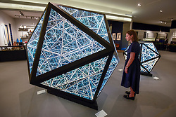 "© Licensed to London News Pictures. 25/06/2019. LONDON, UK. A staff member views "" 80'' Icosahedron "", 2019, by Anthony James from Opera Gallery for the Sculpture Series at a preview of Masterpiece London 2019, the world's leading cross-collecting art fair held in the grounds of the Royal Hospital Chelsea.  The fair brings together 157 international exhibitors presenting works from antiquity to the present day and runs 27 June to 3 July 2019.  Photo credit: Stephen Chung/LNP"