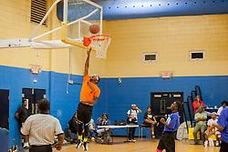 "Brandon Jackson takes the shot.  Milton M. Newton Summer Classic featuring ""Nuff Respect"" (orange) versus  the ""Dream Chasers"".  Charlottel Amalie High School.  St. Thomas, USVI.  10 August 2016  © Aisha-Zakiya Boyd"
