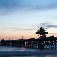 Orange County California San Clemente pier at sunset panoramic photo. Orange County is an affluent area of Southern California in the USA. Panoramic photo ratio is 1:3. Copyright ⓒ 2017 Paul Velgos with All Rights Reserved.