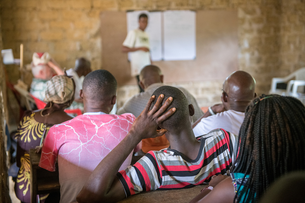 An image of an audience listening to a speaker in Ganta, Liberia