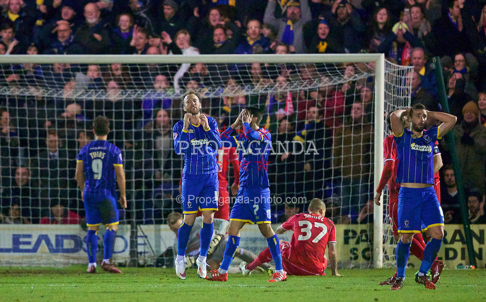 KINGSTON-UPON-THAMES, ENGLAND - Monday, January 5, 2015: AFC Wimbledon's Sean Rigg looks dejected as he shoots over the Liverpool bar during the FA Cup 3rd Round match at the Kingsmeadow Stadium. (Pic by David Rawcliffe/Propaganda)
