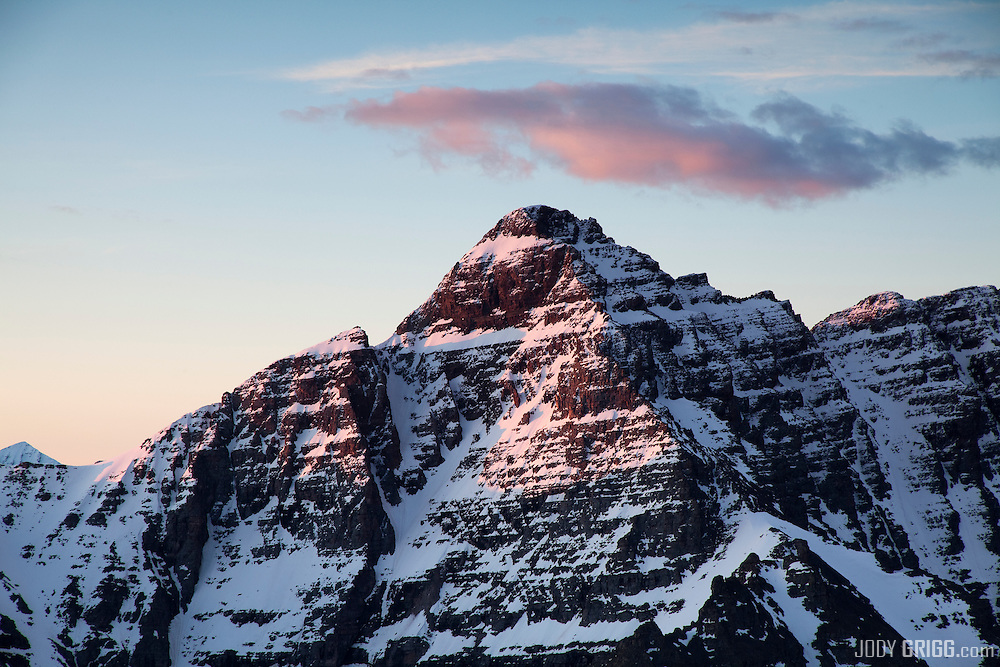 Sunrise strikes Pyramid Peak, Elk Mountains, Colorado.