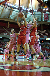 12 February 2012:  MacKenzie Westscott get this possession wedged between Katy Winge and Marley Hall during an NCAA women's basketball game Where the Bradley Braves lost to the Illinois Sate Redbirds 82-63.  It was Play 4Kay day in honor of the cancer research fund set up by Coach Kay Yow at Redbird Arena in Normal IL