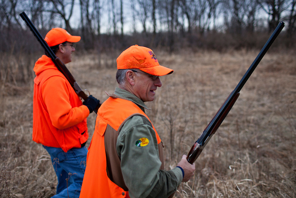 Republican presidential candidate Rick Santorum, left, and Rep. Steve King (R-IA) hunt for pheasants on Monday, December 26, 2011 in Adel, IA.