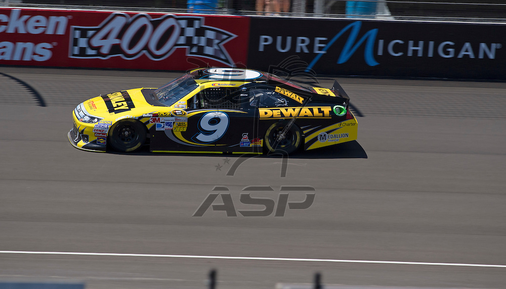 Brooklyn, MI - JUN 15, 2012: Marcos Ambrose (9) during practice for the Quicken Loans 400 race at the Michigan International Speedway in Brooklyn, MI.