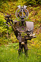 Ticino, Southern Switzerland. Quirky metal sculpture by a local sculptor surrounded by greenery.