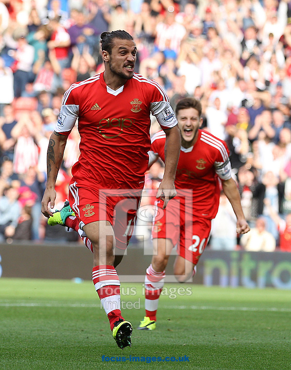 Picture by Paul Terry/Focus Images Ltd +44 7545 642257<br /> 28/09/2013<br /> Dani Osvaldo ( L ) of Southampton celebrates after scoring the opening goal during the Barclays Premier League match at the St Mary's Stadium, Southampton.