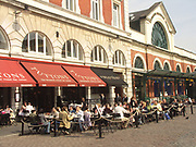 A51P9C Eating outside in Covent Garden London England