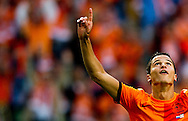 NETHERLANDS, Amsterdam In action Ibrahim Afellay reacts after scoring the  5-0  The Netherlands versus Northern Irland during friendly soccer match between Netherlands vs Northern Irland in Rotterdam on June 2, 2012. AFP PHOTO/ ROBIN UTRECHT