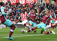 Saido Berahino of Stoke City gets a shot away on goal but it is blocked by Winston Reid of West Ham United during the Premier League match against West Ham United at the Bet 365 Stadium, Stoke-on-Trent.<br /> Picture by Michael Sedgwick/Focus Images Ltd +44 7900 363072<br /> 29/04/2017