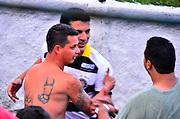 BRASÍLIA, DF, 23.02.2014 – CAMPEONATO CANDANGO – SOBRADINHO vs LEGIÃO – Após goleada do Sobradinho diante do Legião, a torcida do Sobradinho provocou o time adversário e o técnico Bira foi pra cima dos torcedores, onde começou toda a confusão no Estádio Augustinho Lima na cidade satélite de Sobradinho, neste domingo, 23. (Foto: Ricardo Botelho / Brazil Photo Press).