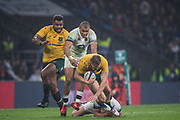 Twickenham, Surrey. UK. Owen FARRELL, hangs onto Reece HODGE, during the <br /> England VS Australia, Autumn International. Old Mutual Wealth Series. RFU Stadium, Twickenham. UK<br /> <br /> Saturday  18.11.17<br /> <br /> [Mandatory Credit Peter SPURRIER/Intersport Images]