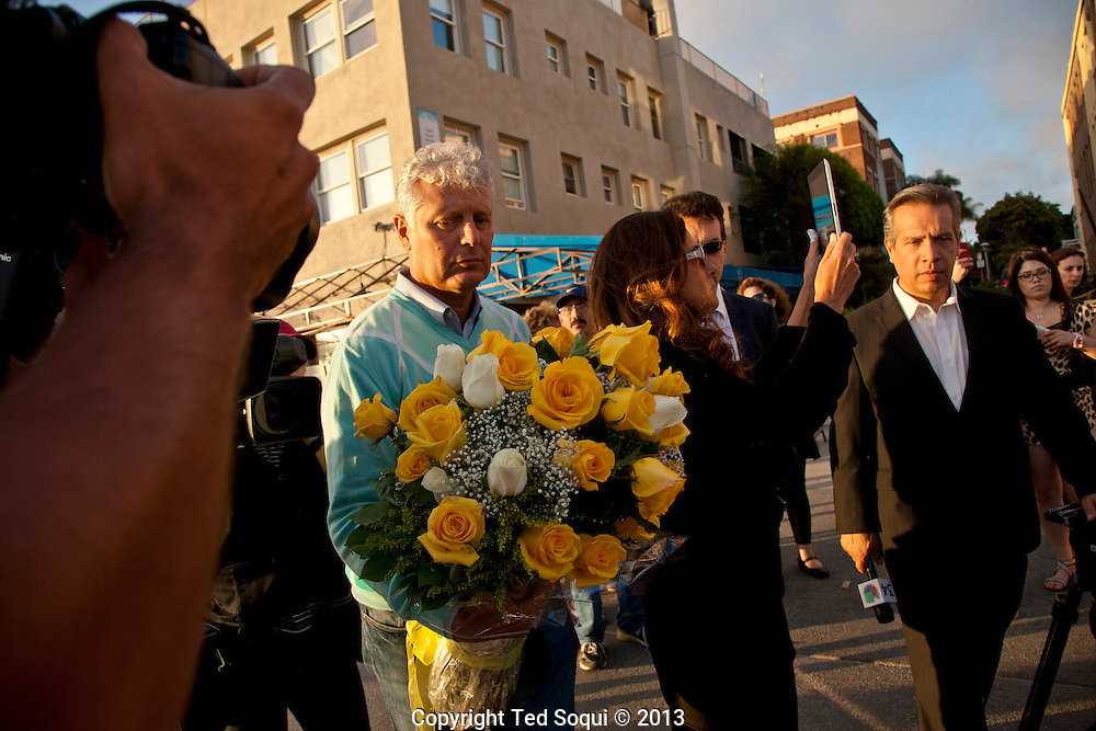 Piero Casadei, step father of Alice Gruppiono, and Katia Gruppioni, Aunt of Alice at the crash site in Venice Beach.<br /> A memorial was held for Alice Gruppioni, who was visiting Venice on her honeymoon and was killed by a deranged driver on the Venice Beach boardwalk. <br /> The driver turned himself in to police and is being held on $1 Million dollars bail. He hit 40 people with his car and injured over 11 seriously.